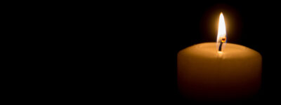 Candle against a black background